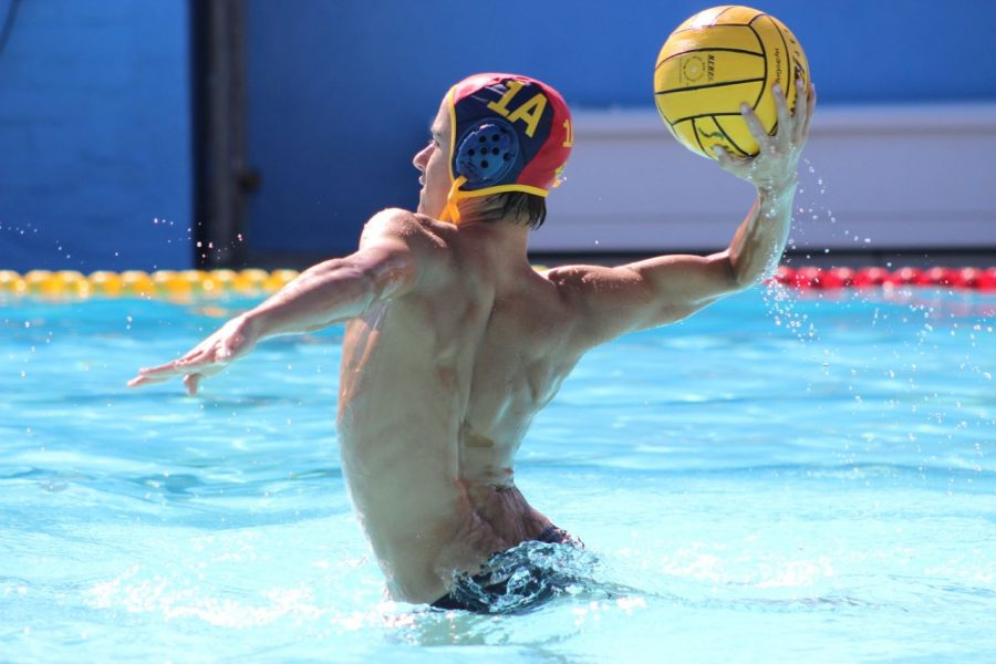 Sophomore Zachary Gephart-Canada prepares to pass the ball down the pool to his team mate.