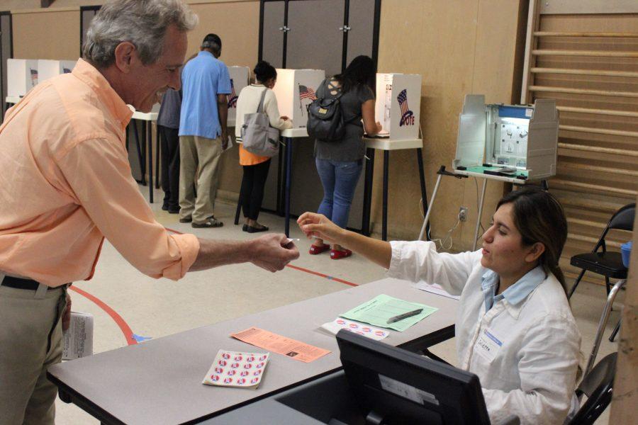 Senior Juliette Tafoya volunteered to work at the polling station today.