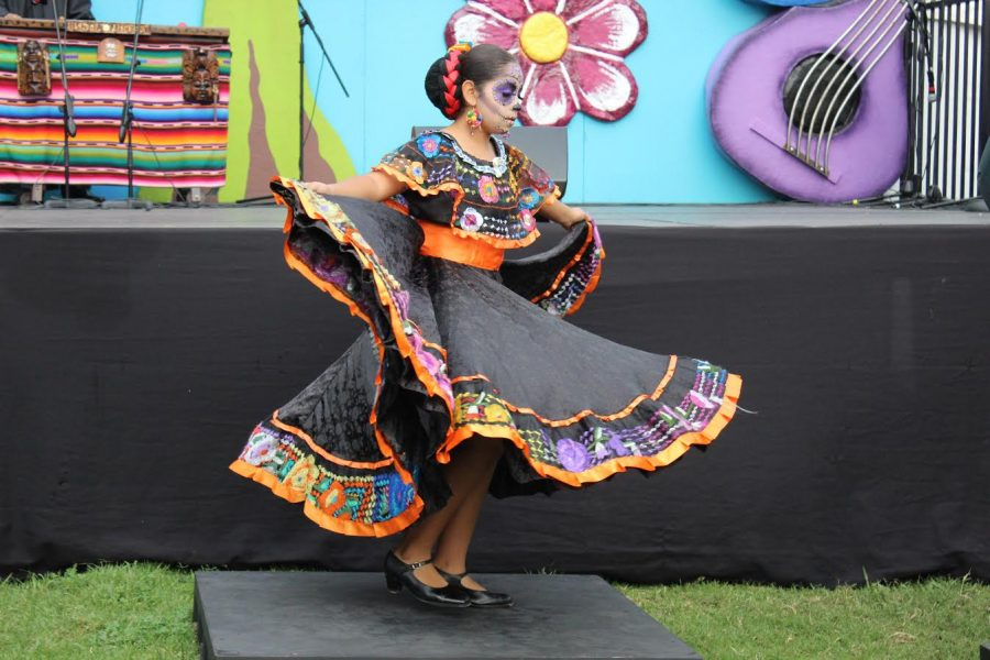 A+young+girl+takes+part+in+the+folklorico+performance.