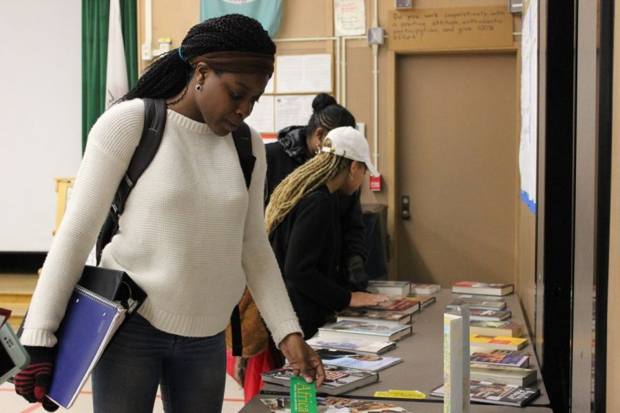 Junior Jade Ajileye looks over the statement pieces that were laid out for students to see. (Ani Kocharyan)