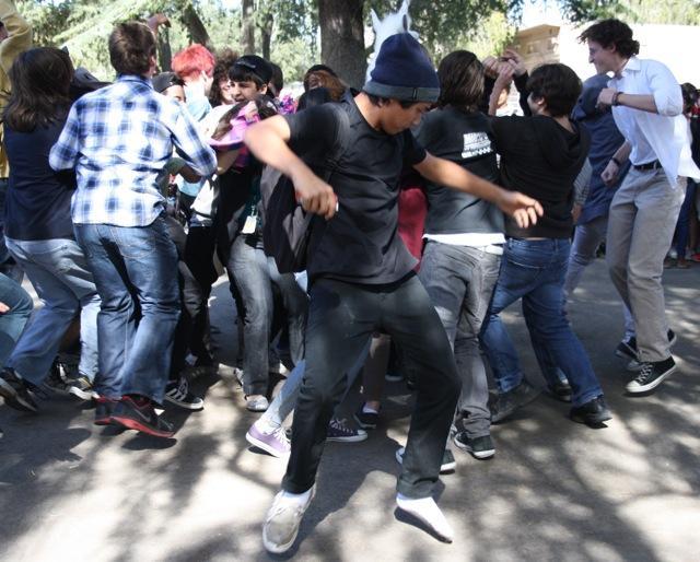 Freshman Adrian Cortes-Heredia takes part in flash mob  during Fiesta Friday. Photo by Ana Perez