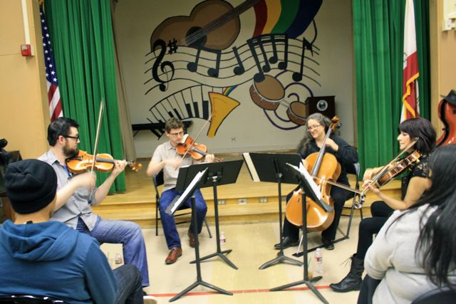 Photo by Rusel Ramirez. The Kadima String Quartet visited Daniel Pearl Magnet High School on March 7 as part of their Young Person's Concert Series.
