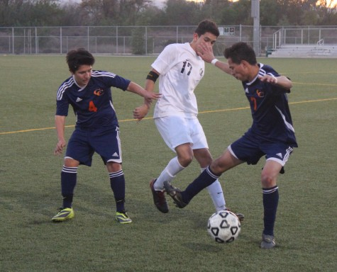 Senior Jonathan Hinojosa tries to keep the ball and move forward a game against Chatsworth.  Photo from