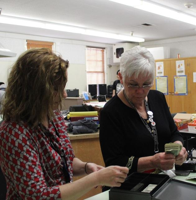 Diane Seiger (right) helps out in the student store on occasion. Photo by Angelo Marmol