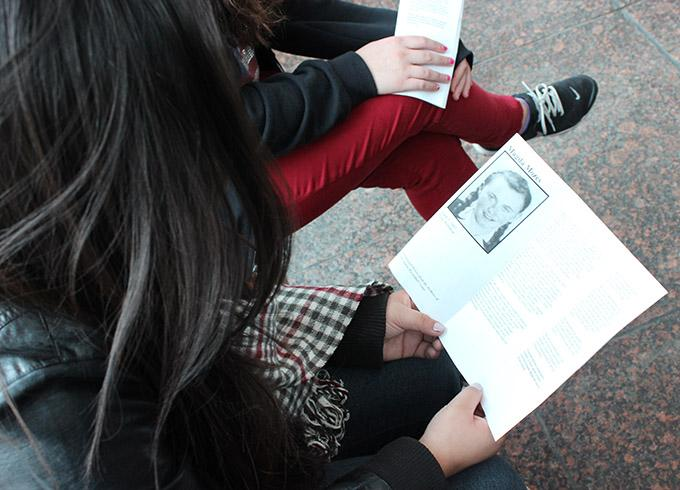 Students on the Museum of Tolerance field trip read booklets about people who experienced the Holocaust. Photo by Hailey Pohevitz.