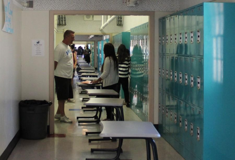 The Class of 2014 lined up desks from social sciences teacher Robert Hoeks in the hallway. The seniors also covered one of his doors with blue masking tape and clear caution tape. Photo by Veronica Godoy
