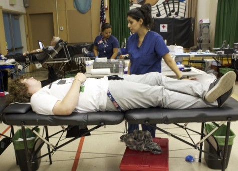 Junior Erich Haines was among the dozens of students and staff who donated blood on Oct. 3 as a part of the blood drive that was hosted by the America Red Cross. Leadership students organized the event. Photo by Veronica Godoy