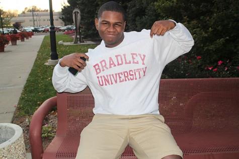 Photo courtesy of  Abigail Hanneman  Patrick Avongnon Jr., former Peal Post editor shows off his Bradley University sweatshirt.