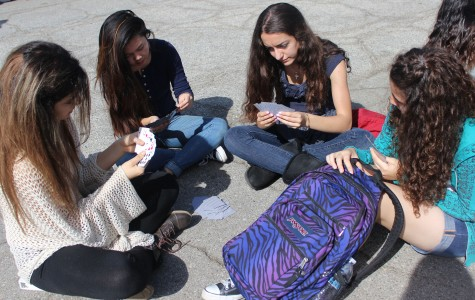 Students pass the time with a deck of cards waiting for the annual Great Shakeout to finish. Photo by Jessica Berrios.
