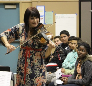 Students listen to the sounds of Beth Elliott's viola. Photo by Monica Hernandez