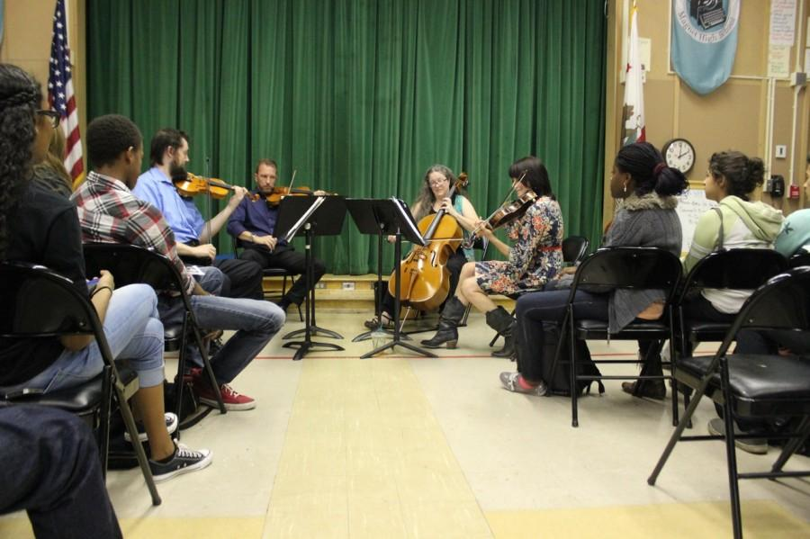 Violinist Erick KM Clark, violinist Brian Benning, cellist Lynn Angebranndt and viola player Beth Elliott perform for students. Photo by Monica Hernandez