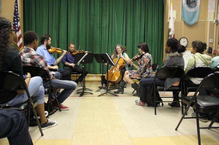 Violinist+Erick+KM+Clark%2C+violinist+Brian+Benning%2C+cellist+Lynn+Angebranndt+and+viola+player+Beth+Elliott+perform+for+students.+Photo+by+Monica+Hernandez