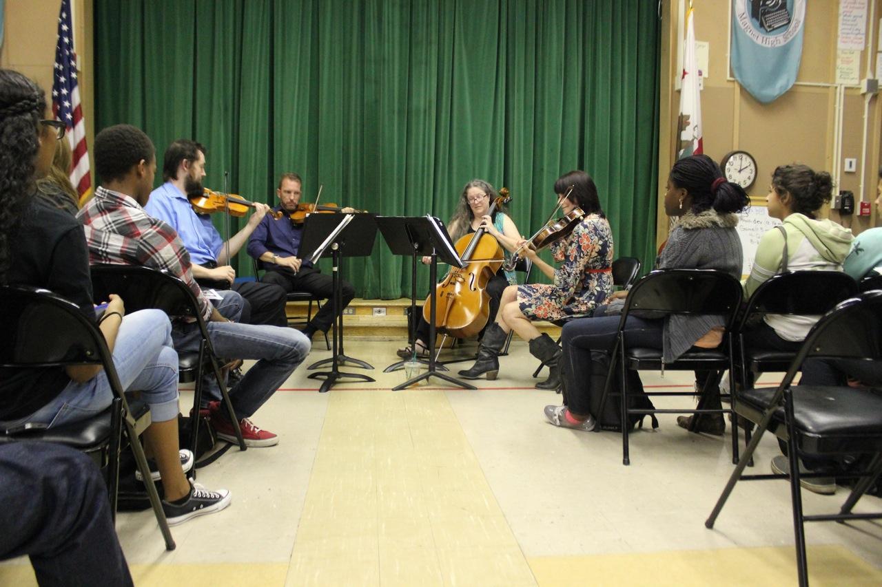 Violinist Erick KM Clark, violinist Brian Benning, cellist Lynn Angebranndt and viola player Beth Elliott perform for students. Photo by Monica Hernandez