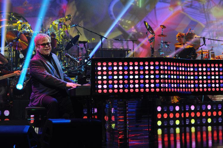 Elton John is known for his eccentric piano performances. Photo from eltonjohn.com