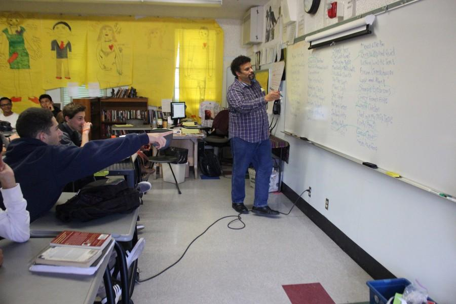 Author Neal Shusterman gives a presentation on writing during a workshop third period today. Students in the 11th grade English class wrote a short story with Shusterman.