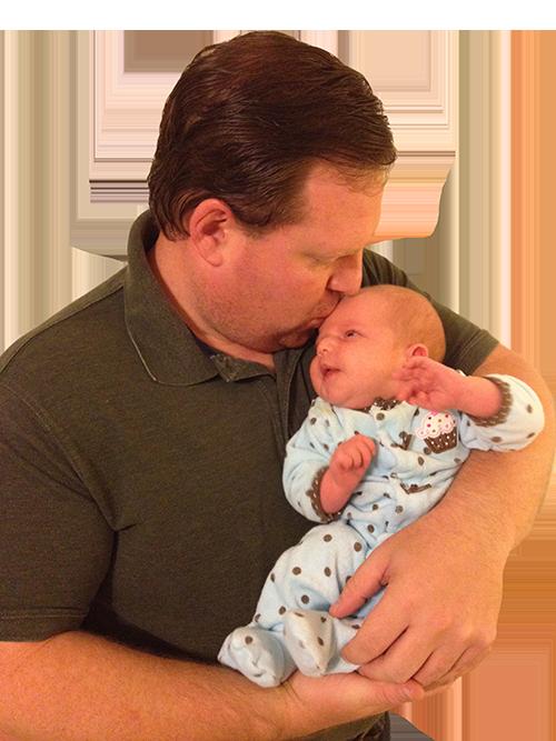 Photo courtesy of James Morrison. Morrison kisses his baby Alice Josephine Morrison.