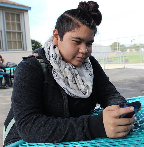 Freshman Lisset Bayardo uses her phone to show that she failed her Life Unplugged project. Life Unplugged is a project conducted in Journalism 1 classes in which students go 24 hours without technology.