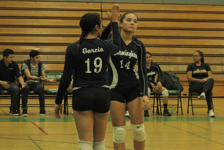 Varsity+player+Michal+Francisco+high+fives+a+teammate+after+the+Lady+Patriots+make+a+good+play+in+the+playoffs.+Photo+by+Jessica+Mallari.