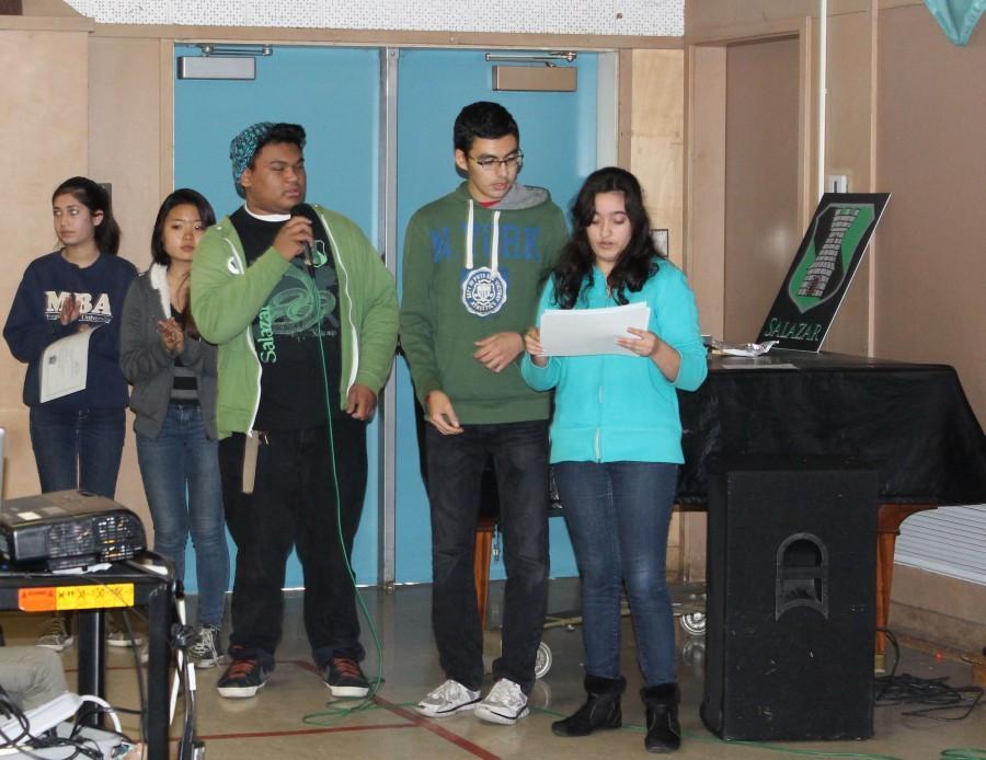 Prefect juniors Cedric Eusantos, Joseph Mousaed and Saba Mahmoudi hand out awards during the Salazar house meeting.