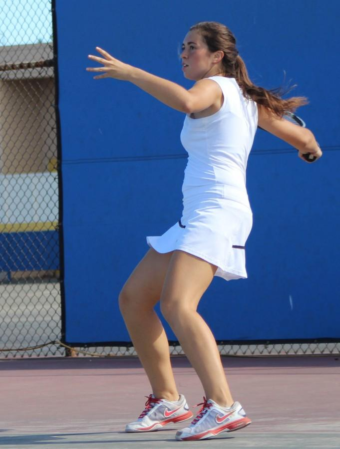 Junior Irene Feher readies her tennis racket to return the ball to her opponent during a practice game.