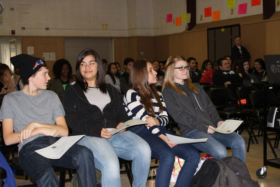 Freshmen Owen Duffy, Jessica Salguero, Ani Kocharyan and Alice Curran sit at the Clemens House award ceremony on Friday with their awards. Friday was the last day of the fall semester.