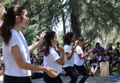 Members of the drill team perform their routine in the Grove for a captive audience on the May 16 Fiesta Friday.