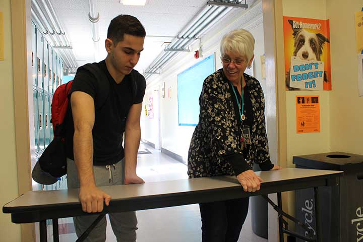 Top right: Seiger moves the table at the front office with sophomore Alex Ter-Minasyan during lunch.