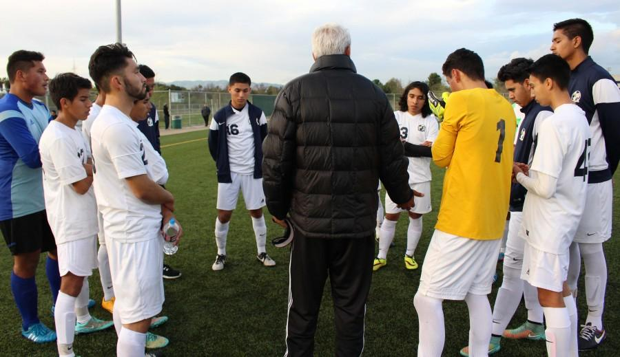The boys varsity soccer team gathers to raise moral as the members prepare for a home game against Granada Hills Charter High School on Jan. 30 in Balboa Park.