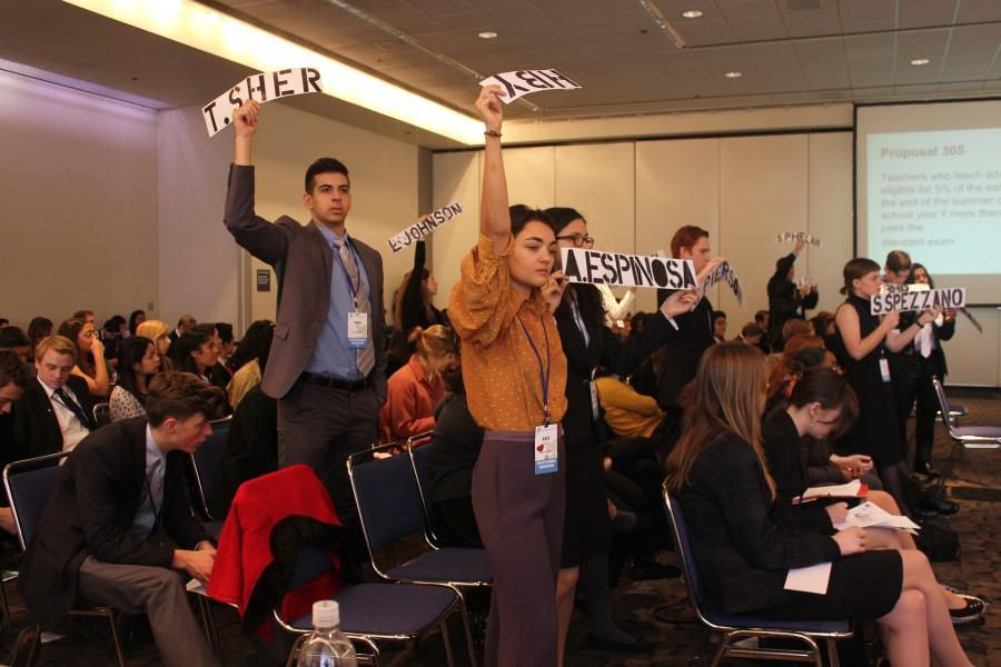 Students vote for their chosen delegate as a part of the mock Sacramento experience at the youth government program.