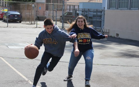 Junior Maxim Grinfeld dribbles past junior Jessica Ramos, a shooting guard for the BCCHS girls basketball team, in a one on one match during 6th period at DPMHS.