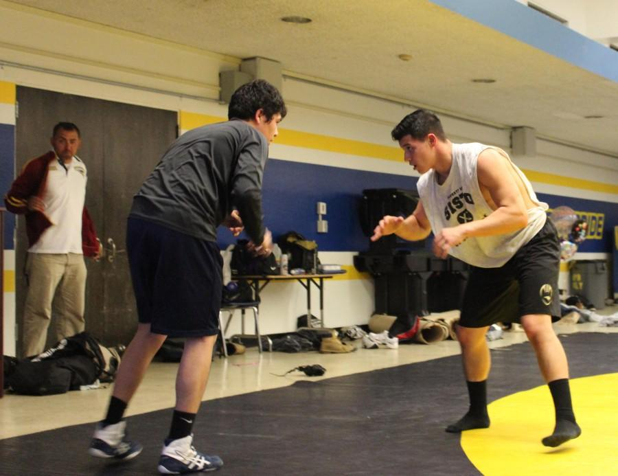 Junior Stanley Cea keeps his stance as his wrestling buddy gets ready to launch himself at Cea.