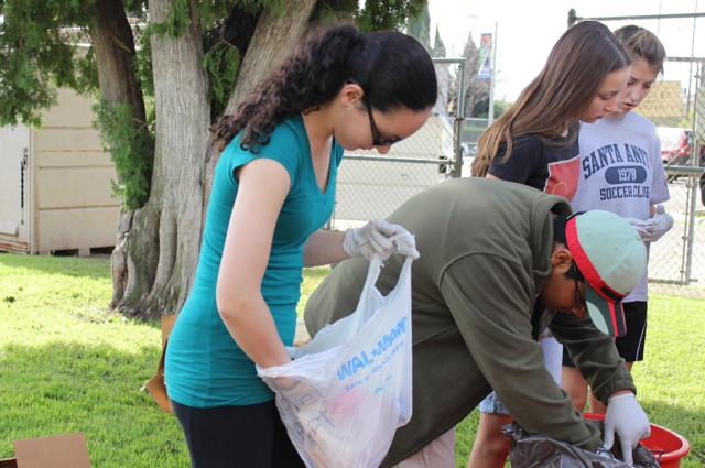 Students+help+clean+out+the+emergency+supplies+container+during+the+schools+annual+Sparkle+Saturday.