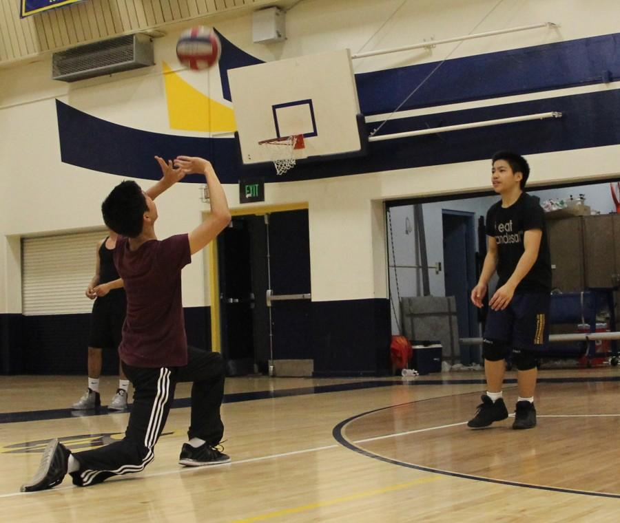 Sophomore Jonas Acebes sets to sophomore Jon Dumindin on a one-on-one drill at Birmingham's main gym to prepare for their season that started March 25.  The Patriots have an overall record of 3-4 for the season.