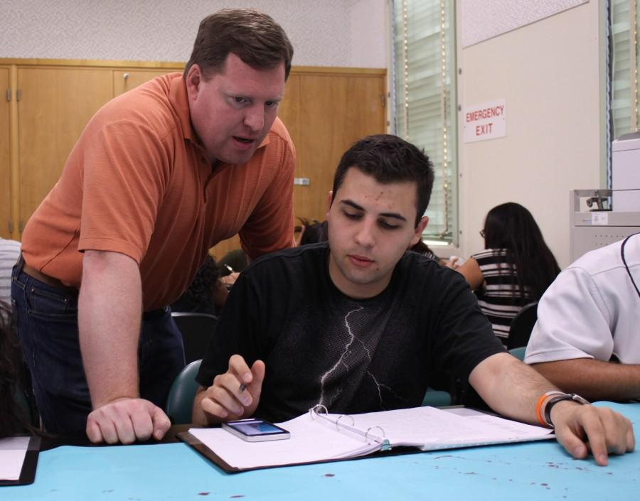 Anatomy and Physiology teacher James Morrison helps senior Mher Mkrtchian with a question he has about the lab.