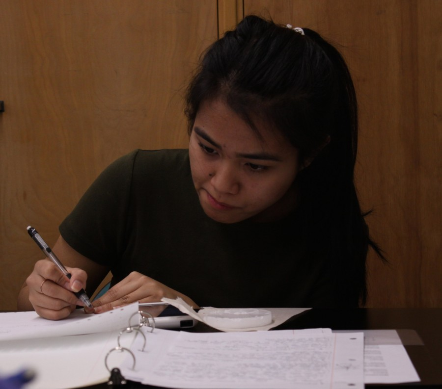 Senior Jean Blas writes down notes during her Anatomy and Physiology lab on April 29.