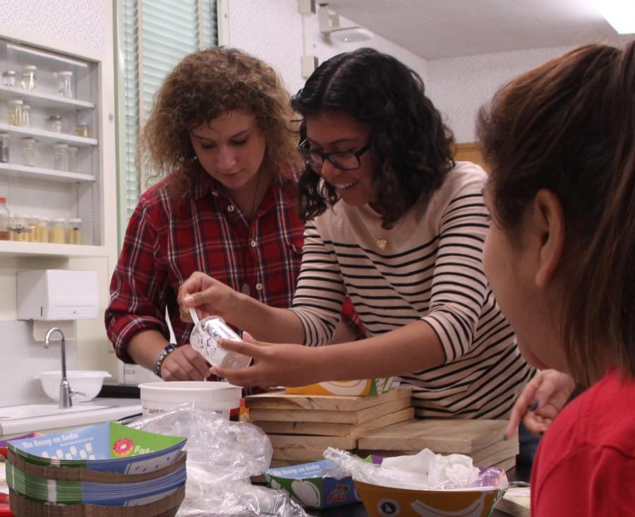 Seniors Boa Pistol-Boesch and Gabriella Avendaño make plaster-like substance to mold tool marks. The fourth lab activity, which required less observation, was the more active part of the lab.