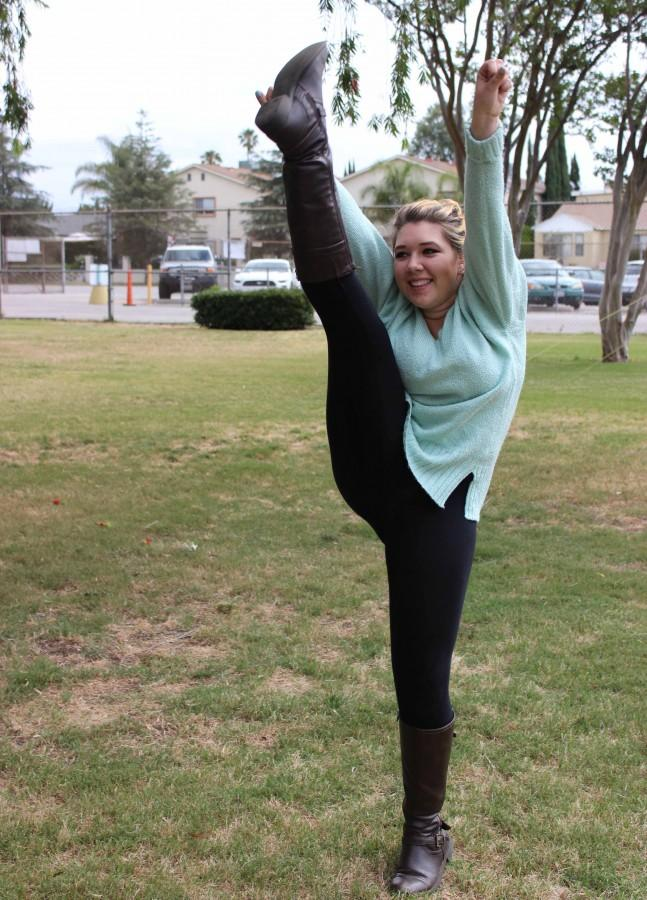 Junior Jamie Timsit cheers  on the Grove at DPMHS.  Timsit along with junior Valeria Sanchez made the BCCHS cheerleading team this spring and will be cheering next fall.