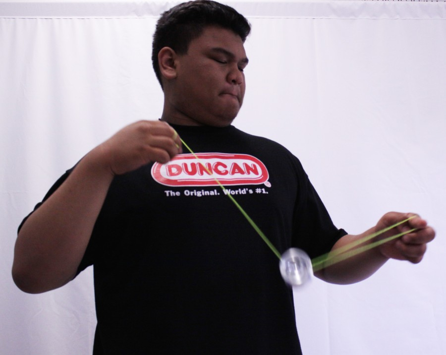 Requiring more than just the flick of a wrist, junior Cedric Eusantos preforms one of the many yo-yo tricks he has learned over years of practice.