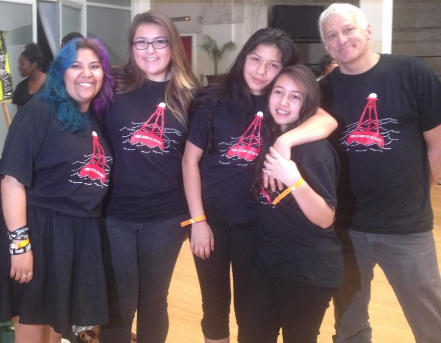 Senior Ambar Marin and freshmen Meghann Blake, Zyanya Fuentes and Paola Rivas stand with English teacher and poetry coach Ron Baer after their participation in the Get Lit Poetry Slam.
