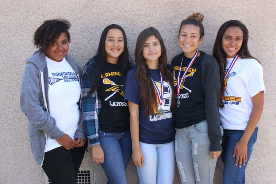 Tahra Hunter, Andrea Escamilla, Brianna Lopez, Ana Perez and April Serrano wear their medals for their superb victory in the lacrosse city championship finals.