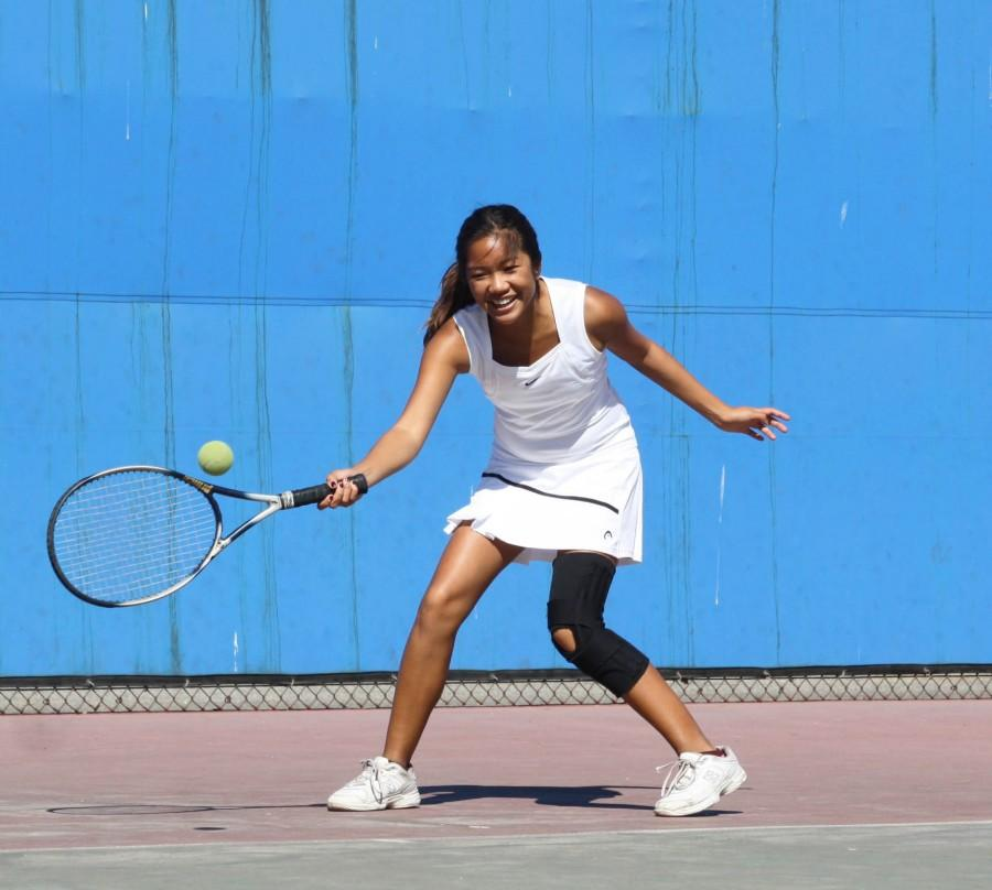 Senior Elyssa Gorospe returns the tennis during a match at BCCHS' tennis courts.