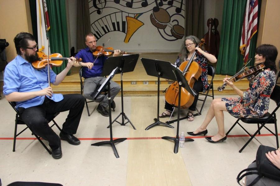 Kadima String Quartet plays for students