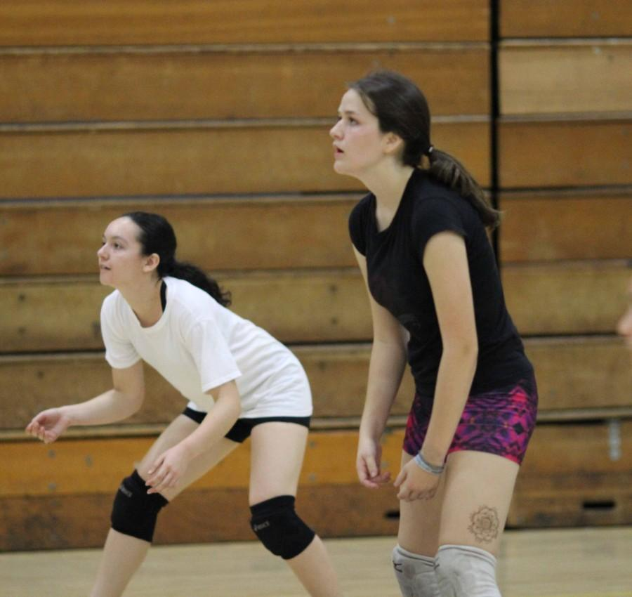 Juniors Savannah Orrill and Lissa Favela get in position, waiting for the ball.