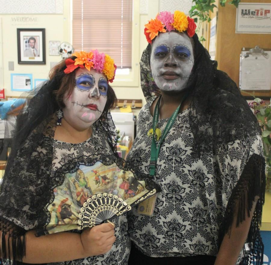 Lupe Osorio and Ms. Madge drew inspiration from Day of the Dead for their Halloween costume.