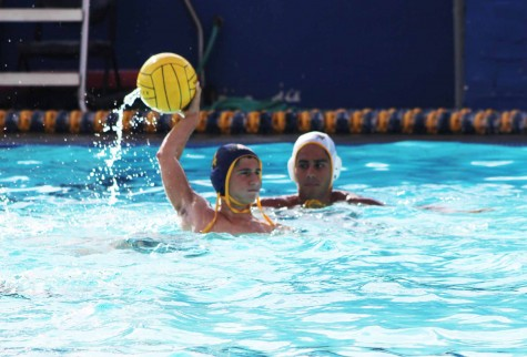 Senior Maxim Grinfeld arches back to shot the ball. The water polo team aims for city champions.