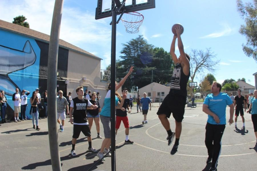 Senior Jeremy James, goes up to make the shot during Fiesta Friday. Where first ever senior vs staff basketball game was played. (file photo)
