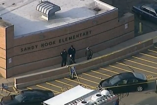 Officers stand in front of Sandy Hook Elementary in Connecticut, the site where a mass shooting of elementary school children occurred in 2012. Many people view this school shooting as one of the most gruesome shootings in United States history and one where gun control and other precautions should have prevented.