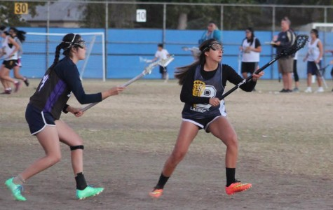 Junior April Serrano avoids her defender while catching the ball during tryouts.