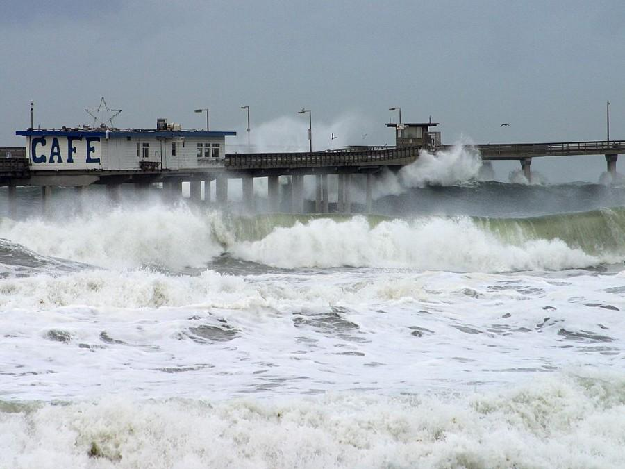 A storm causes massive waves to crash into a dock. Storms are expected when El Niño arrives in Southern California early next year.