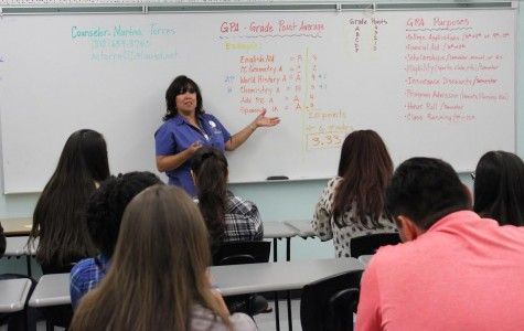 Counselor Martina Torres teaches current DPMHS families about grade point averages (GPA) during student orientation in August. Torres explained how GPAs are calculated and how students can make the honor roll.